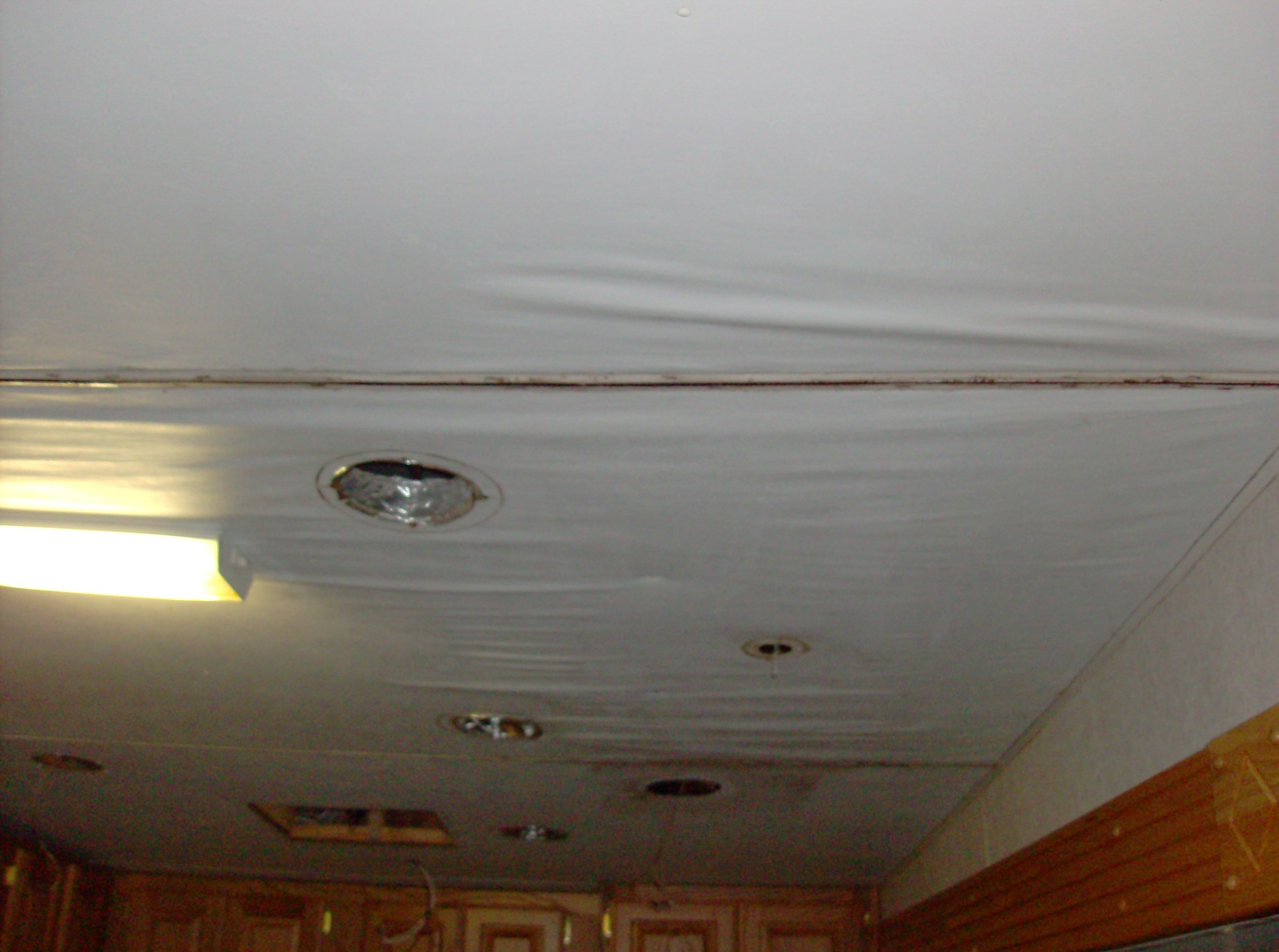 water damage to the ceiling & the roof